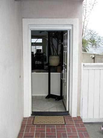 Secret screen pull down retractable screen doors for Pull down retractable screen door